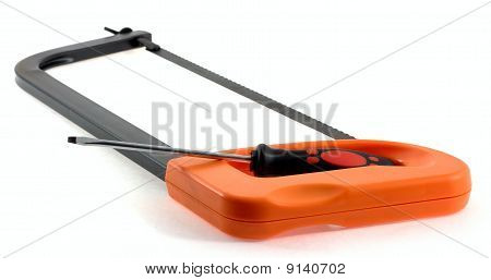 Hacksaw And Screwdriver On A White Background