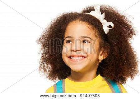 Cheerful African girl wearing white bow in hair
