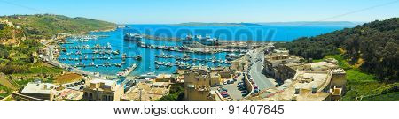MGARR, MALTA - APRIL 14, 2015: Panorama view on Mgarr port with ferry on Gozo island, Malta.