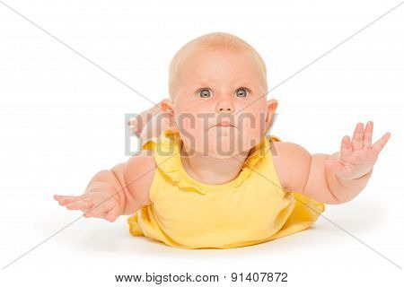 Chubby baby laying on the belly in yellow bodysuit