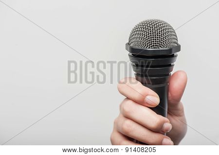 microphone is hold by girl tv journalist