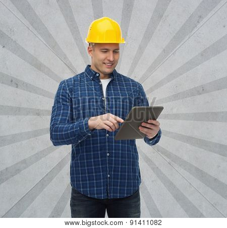 repair, construction, building, people and maintenance concept - smiling male builder or manual worker in helmet with tablet pc computer over gray burst rays background