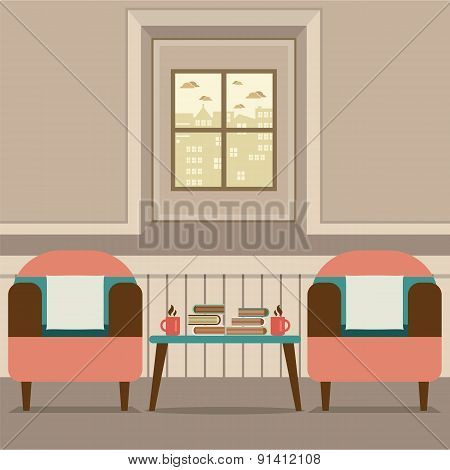 Two Sofas With Hot Coffee Cup And Books On Table.