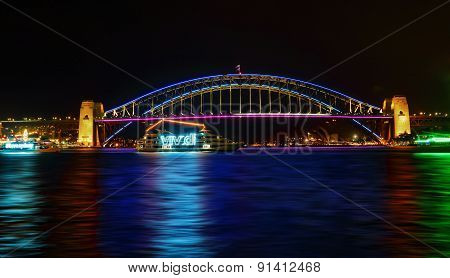 Vivid Sydney- Boats Cruise By Sydney Harbour Bridge In Colour