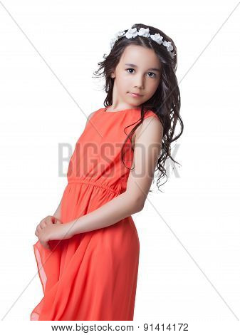 Adorable little model posing in stylish red dress