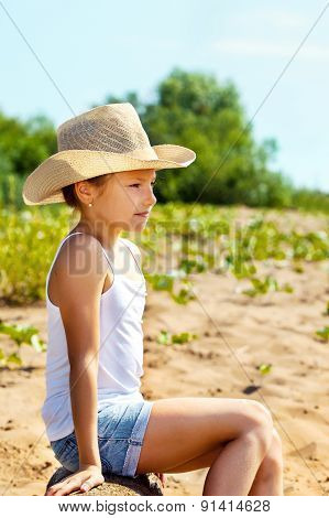 Beautiful young girl resting in park summer