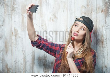 Cheerful Hipster woman with gadget