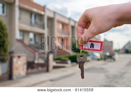 Real Estate Sells House And Holds Keys In Hand