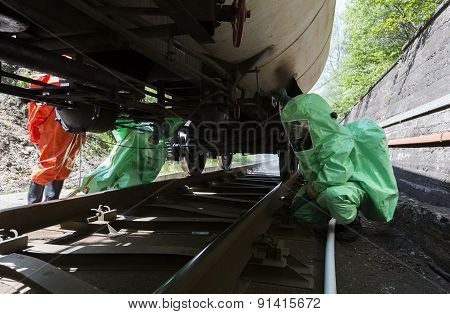 Toxic Chemicals And Acids Emergency Team Checking Tank