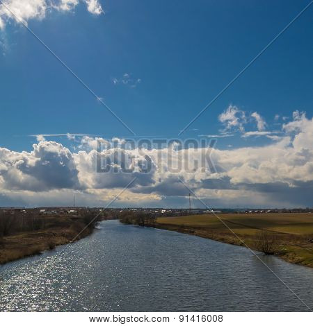river with blue skies
