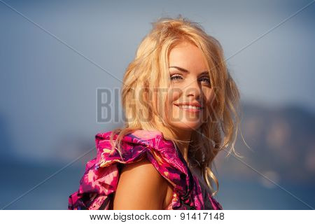 Portrait Of Blonde Girl In Purple Dress