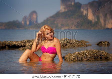 Blonde Girl In Swimsuit Half In Sea Water