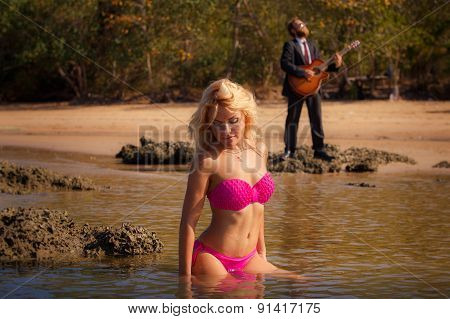Blonde Pretty Girl In Pink Swimsuit Sit In Shallow
