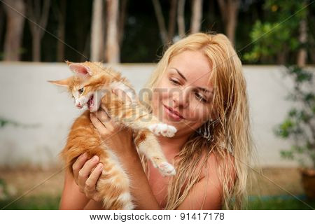 Blonde Girl And Red Kitten Near House