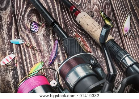 Fishing Tackle Spinning On A Wooden Table