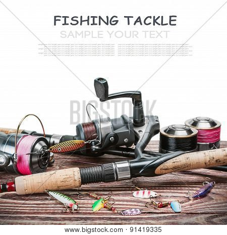 Fishing Tackle On A Wooden Table Isolated