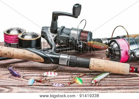 Fishing Tackle On A Wooden Table Isolated On A White