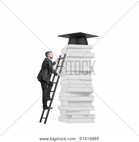 A Student Is Climbing Up To Get University Degree. Pile Of Books And A Graduation Hat As A Prize. Is