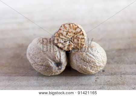 Nutmeg On An Old Wooden Table
