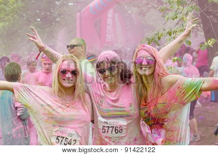 Three Happy Smiling Woman Covered With Pink Color Powder