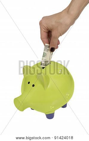 Green Piggy Bank And Woman Hand Isolated Over White