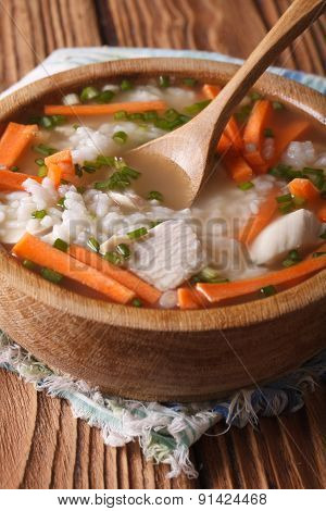 Homemade Food: Chicken Rice Soup In A Wooden Bowl. Vertical