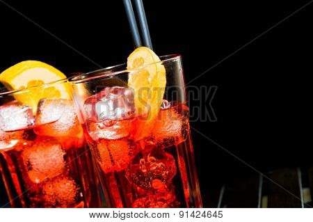 Spritz Aperitif Aperol Cocktail With Orange Slices And Ice Cubes On Black