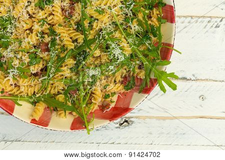 Pasta Fusilli With Fresh Garlic And Rocket Leaves, Spanish Chorizo, Parsley, Parmesan Cheese