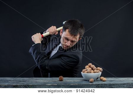 young man stabs a nut