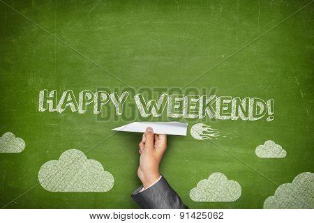 Happy weekend concept on green blackboard