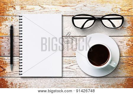 Blank Diary And Coffee Cup On A Vintage Wooden Surface