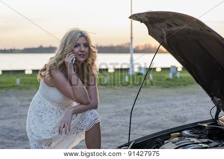 Blond Woman And Damaged Car