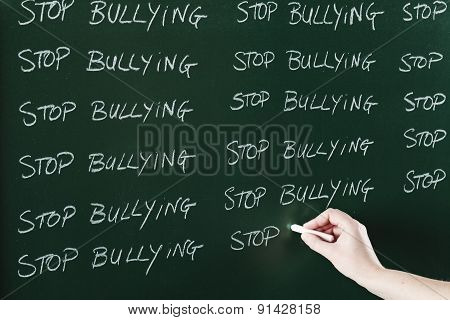 Stop bulling message written on black board as punishment