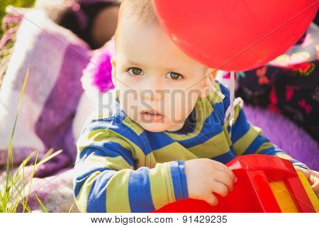 Close Up Portrait Of Cute Little Baby Boy Playing With Toys