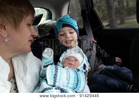 Family Looking At Newborn Baby