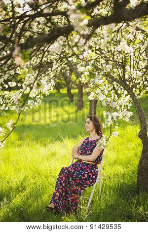 Portrait Of Beautiful Young Woman In Spring Garden