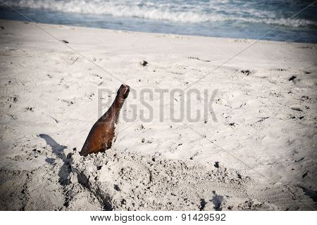 Bottle Of Beer Stuck In The Sand