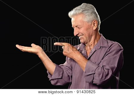 Mature man pointing
