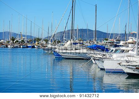 Boats In Alghero Harbor On A Clear Day