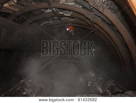 Donetsk, Ukraine - March, 14, 2014: The Driver Of The Coal Miner Working In A Cloud Of Dust In The U