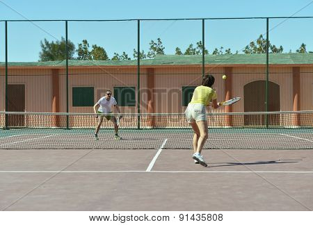 Tennis players standing near net