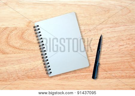 Notebook And Pen On Wood Texture