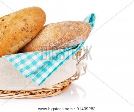 Fresh french bread in basket. Isolated on white background