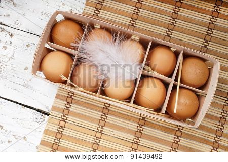 Brown eggs in egg box