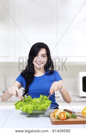 Attractive Woman Prepare Vegetable Salad