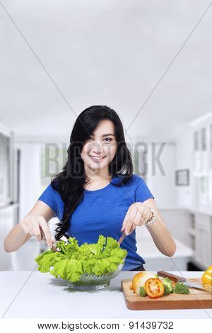 Beautiful Housewife Mixing Fresh Salad