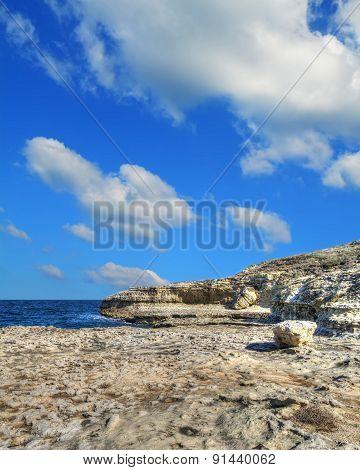 Rocky Shore Under Clouds In Sardinia