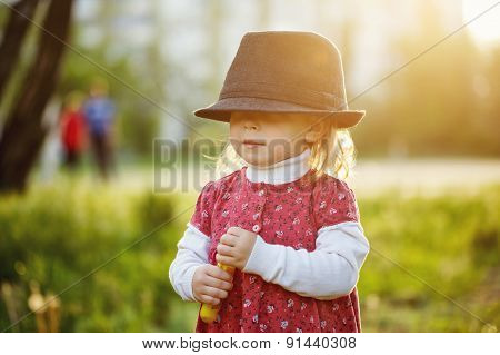 Portrait Of Cute Little Girl In Hat. Spring.