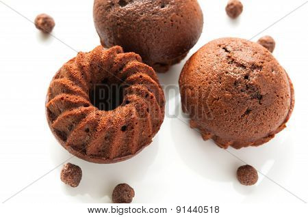 Chocolate honey spongecake or muffin on white background plate