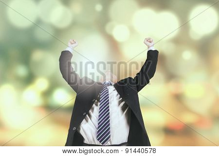Happy Entrepreneur With Light Glitter Background